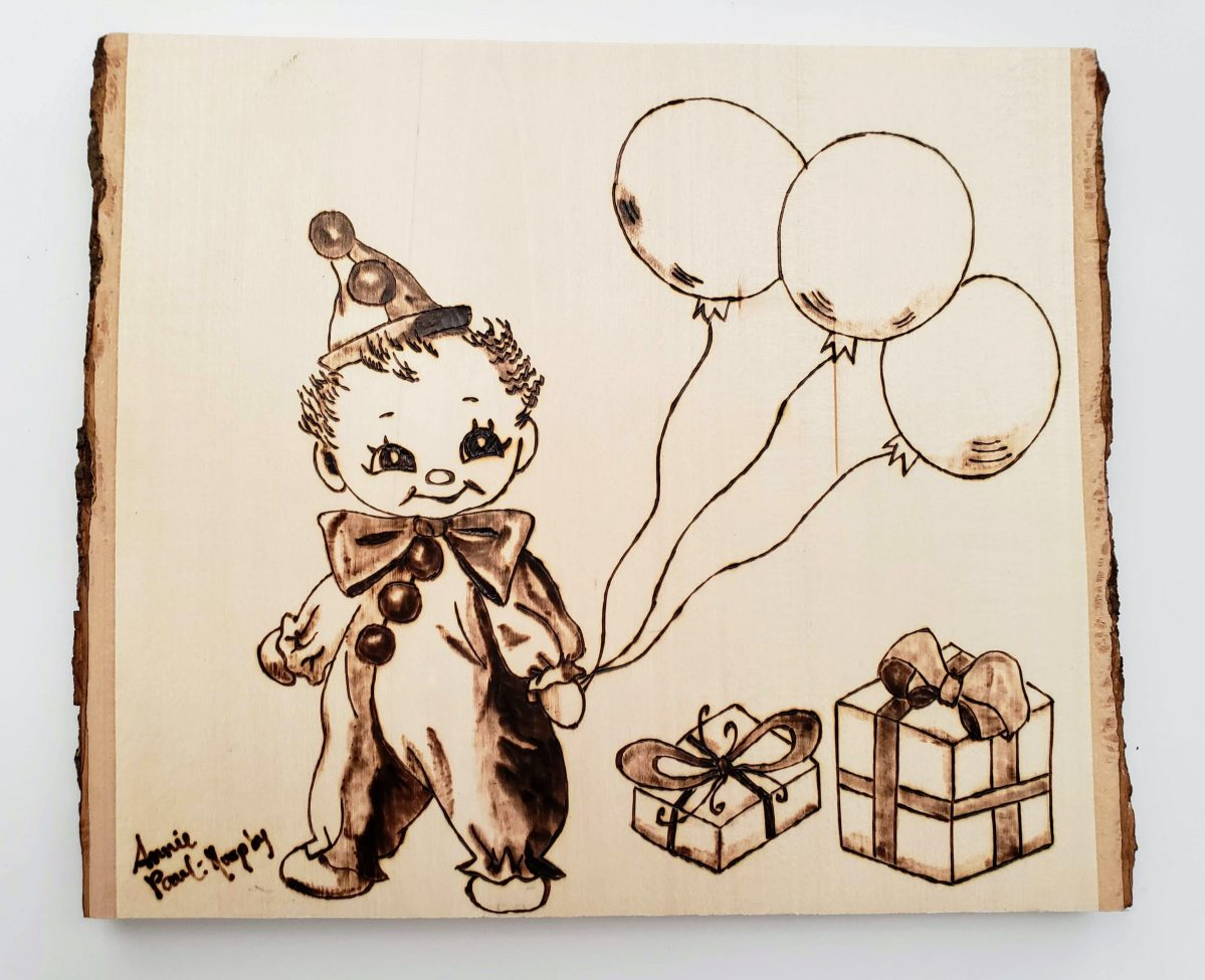 Woodburned baby clown